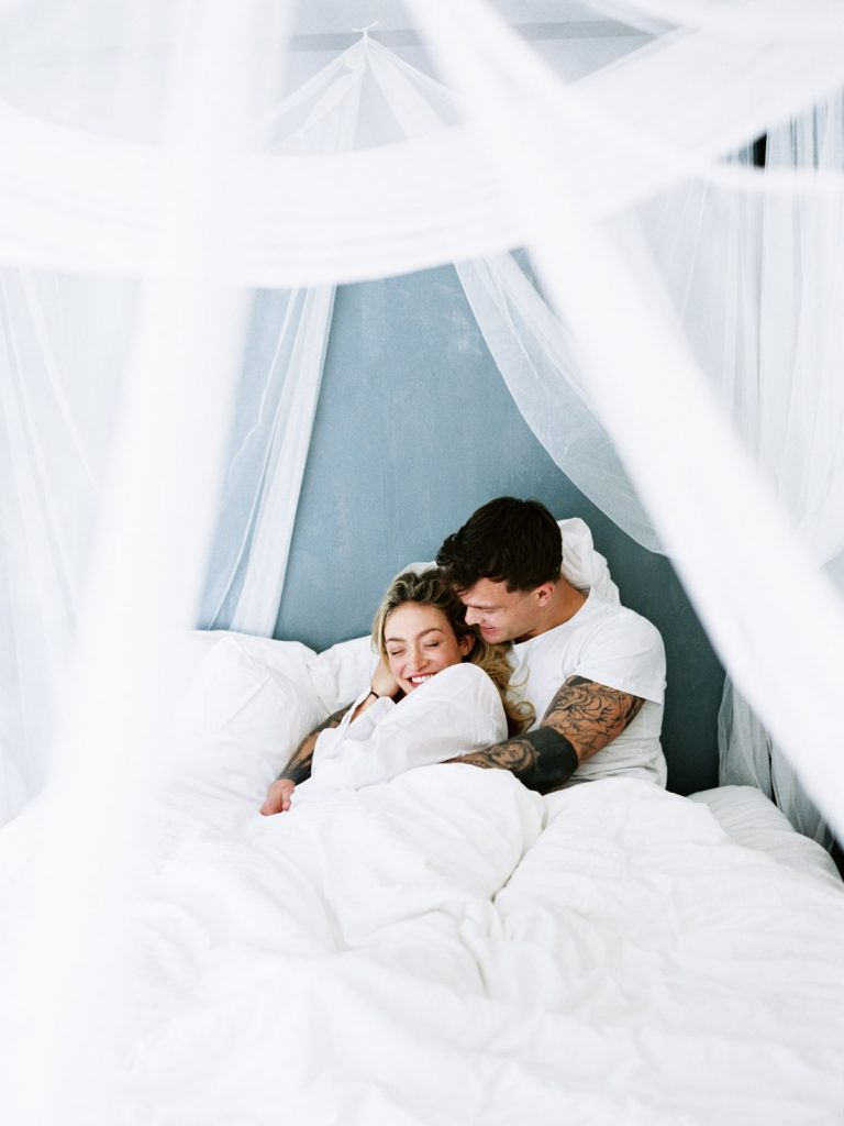 engagement Photo of the couple on the bed