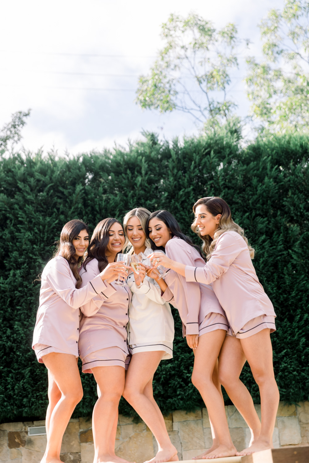 photo of Bride with bridesmaids having champagne