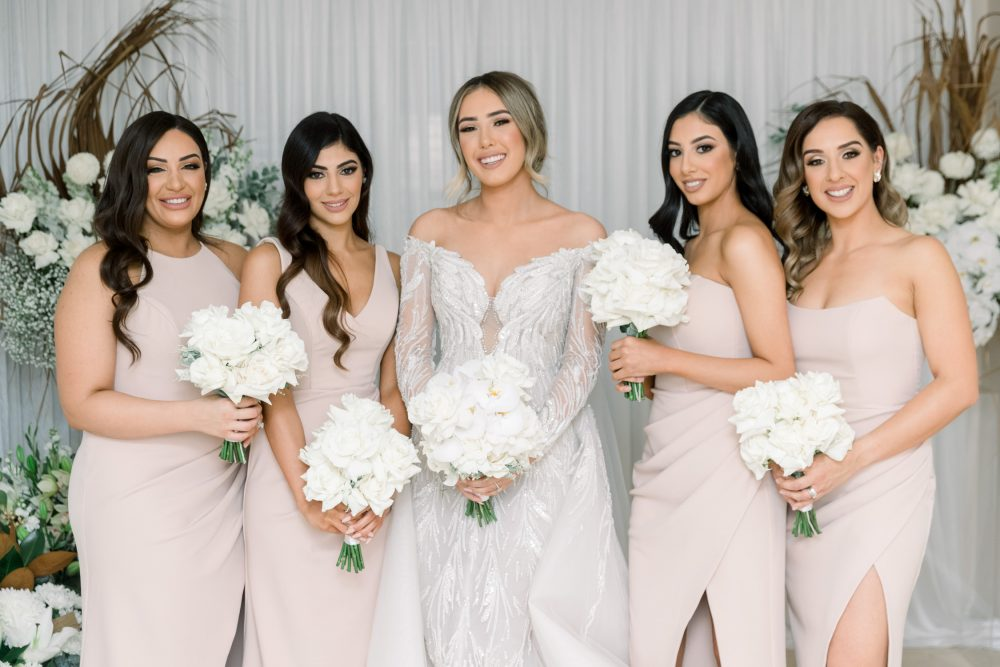Bride and bridesmaids' portrait with steven khalil wedding gown