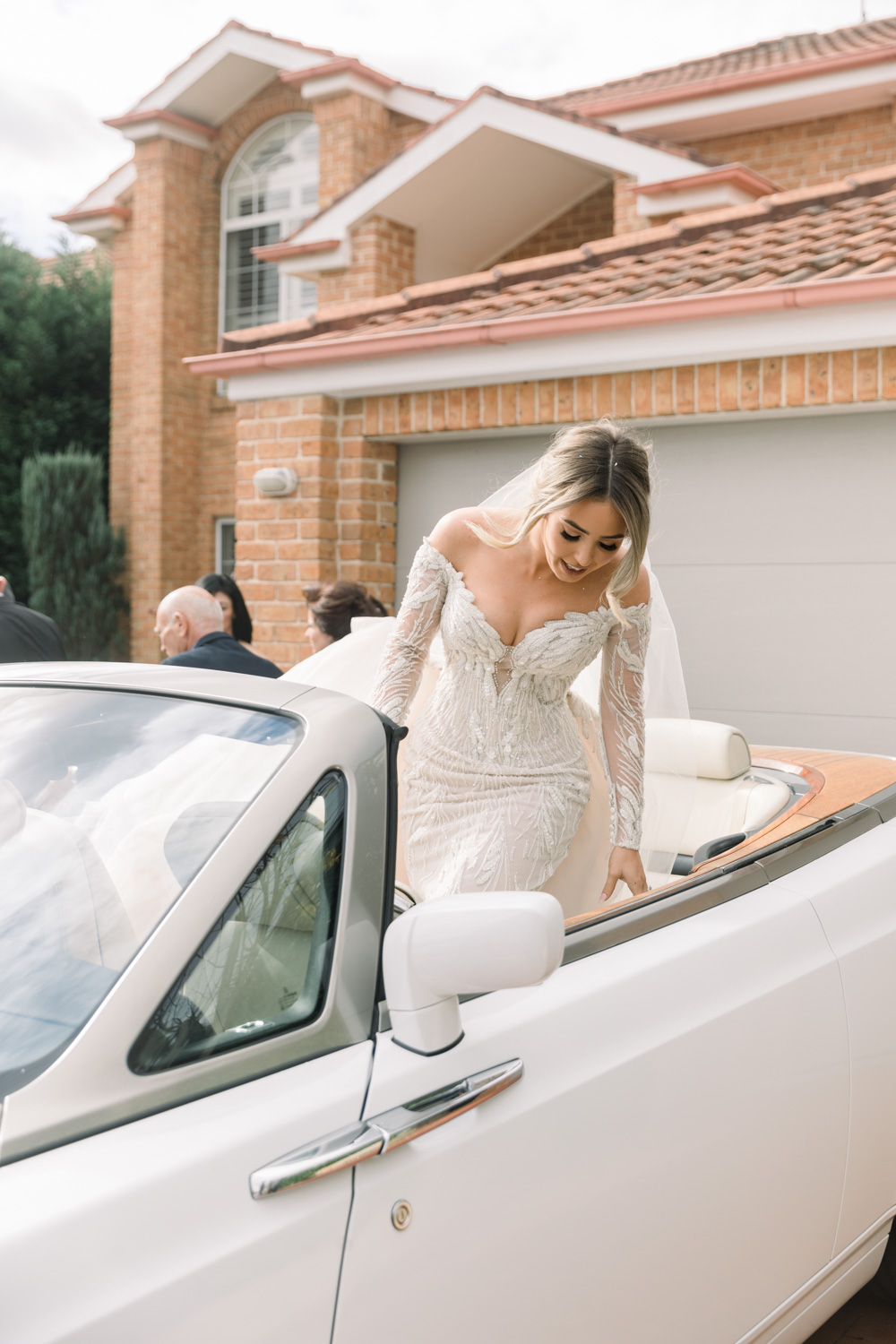 bride leaving her house for wedding ceremony