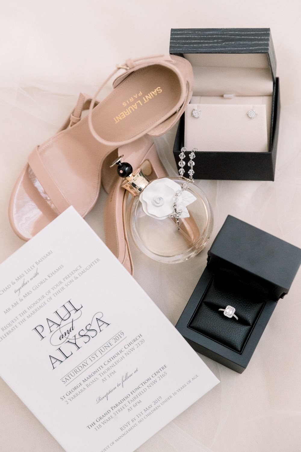 bride's accessory includes engagement ring, saint laurent wedding shoes, invitation cards and earings.