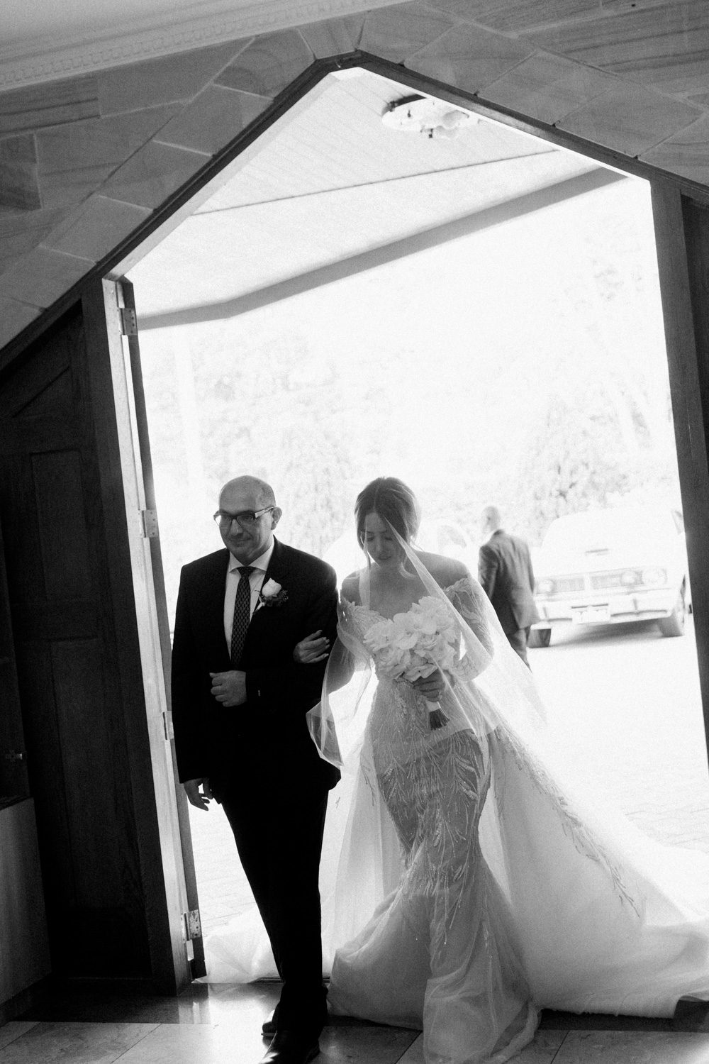 Bride walking down the aisle with her father