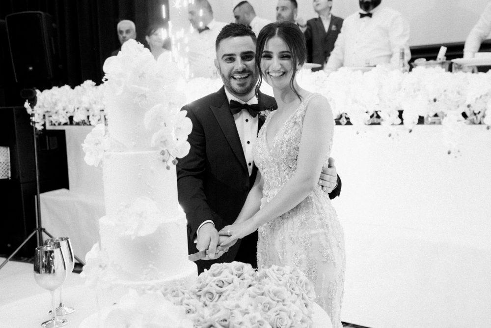 cutting of the wedding cake photos