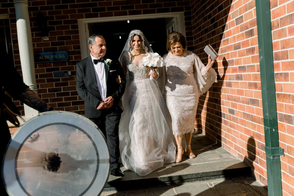 photos of bride leaving the house