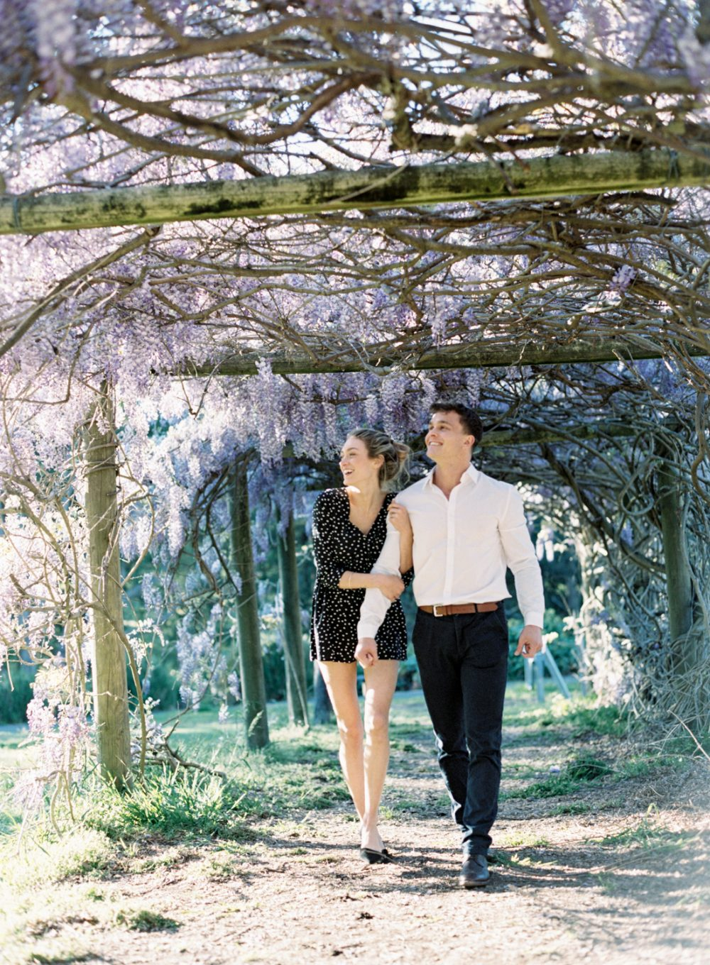 we are Sydney fine art film wedding photographer and we shott this beautiful engagement session in local park with Spring blossom as a backdrop.